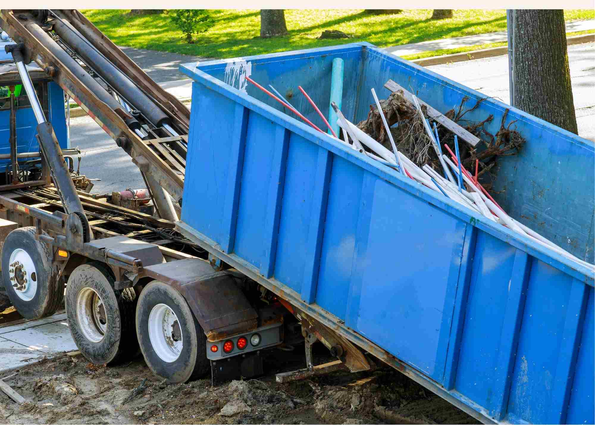 On this image you see a dumpster rental Brooklyn team is delivering a 30 yard dumpster to our client's site project. Client is doing a full renovation of the house and needed a dumpster for concrete and backyard work. The image was taken in January 2021