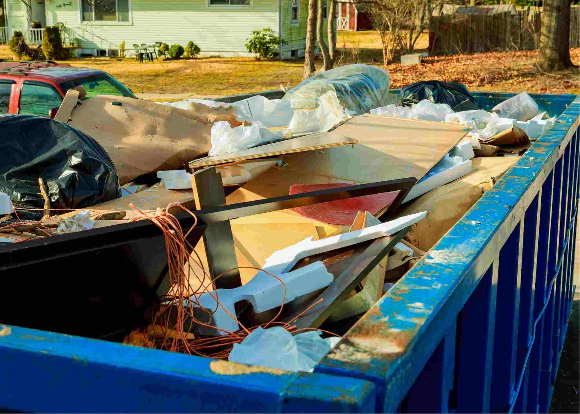 Junk Removal Brooklyn projects are very in demand. On this picture you see a junk removal dumpster filled in with furniture and household items. Our clients inherited a house and needed to remove the junk. The image was taken in April of 2021