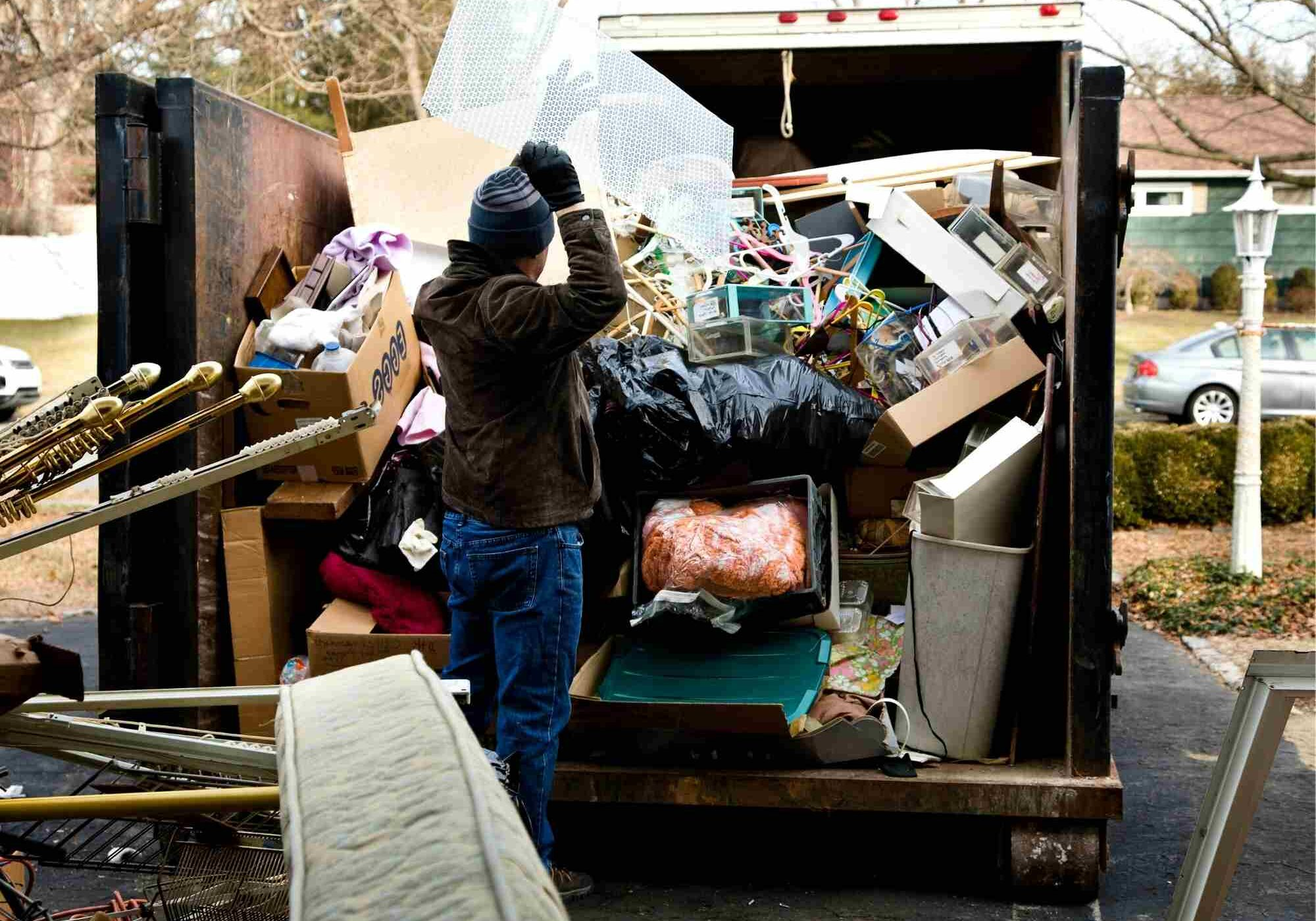 On this image you see a junk removal Brooklyn project is taken place. Junk removal dumpster was delivered to our client to clean up clutter house. Appliances, mattresses and other junk is being hauled away by our dumpster rental company in Brooklyn. The image was taken in April of 2021